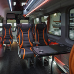 Black and red seats in minibus